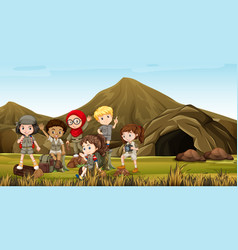 Kids in safari costume camping out by the cave vector
