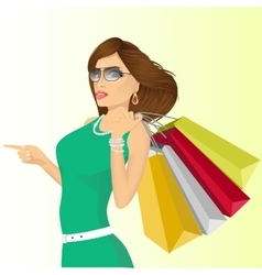 Young haughty woman with shopping bags vector