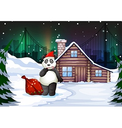 A Santa panda with a red sack full of gifts vector image