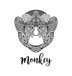 Monkey head with ethnic motifs vector