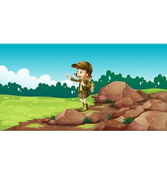 A female explorer near the rocks vector