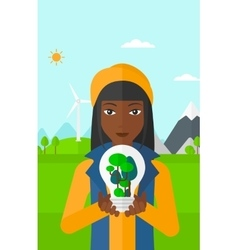 Woman with lightbulb and trees inside vector
