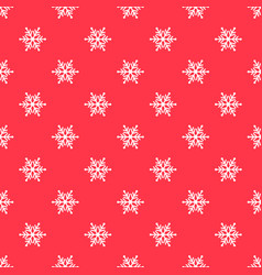 Red pattern with white snowflakes vector