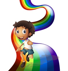A boy dancing above the rainbow vector image vector image
