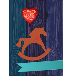 Rocking horse with a heart shaped balloon vector