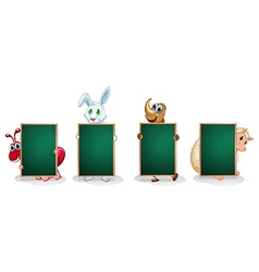 Four animals with empty green signboards vector image