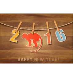2016 with a goat on wooden background vector