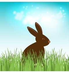 Brown cute chocolate bunny in grass easter vector