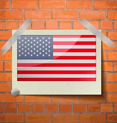 Flags usa scotch taped to a red brick wall vector