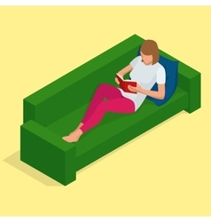 Young pretty woman lies on a sofa and reading a vector