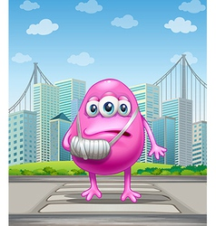 An injured pink monster crossing the street vector