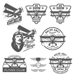 Set of vintage biplane emblems design elements vector