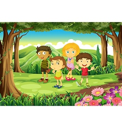 Four kids at the forest vector image