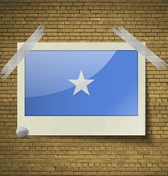 Flags somaliaat frame on a brick background vector