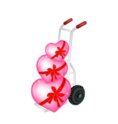 Hand Truck Loading Three Beautiful Red Heart vector image