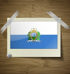 Flags san marino at frame on wooden texture vector