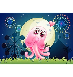 An in-love pink monster near the carnival vector image