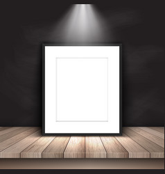 Blank picture leaning against chalkboard vector