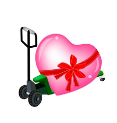 A pallet truck loading a big heart vector
