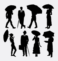 People with umbrella silhouettes vector
