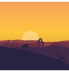 silhouette of couple kissing in sunset dramatic vector image vector image