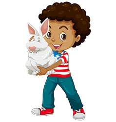 American boy holding a white rabbit vector