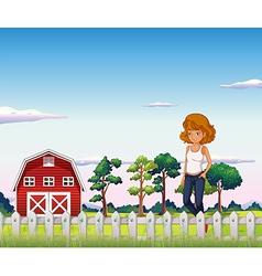 A girl standing near the red barnhouse inside the vector