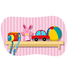 camera and other toys on wooden shelf vector image vector image