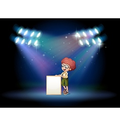 A boy holding an empty frame on the stage with vector image vector image