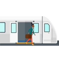 Woman going out of train vector image