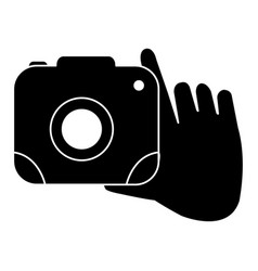 Hand with camera photographic isolated icon vector