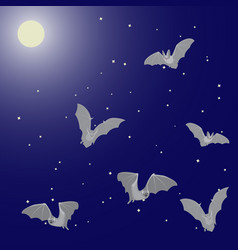 Flying bats in the night sky with the moon and vector