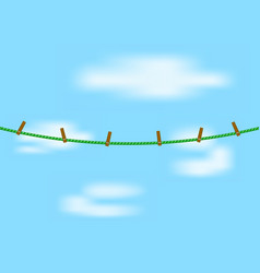 Clothespins on green rope vector