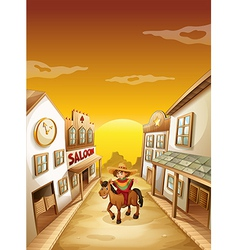 A boy riding in a horse outside the saloon vector