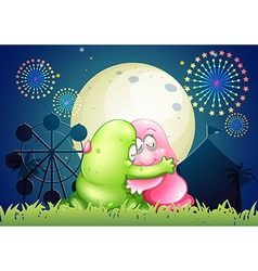 A pink and a green monster hugging each other in vector