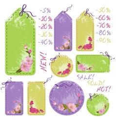 Spring sale tags with cherry flowers vector