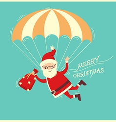 Santa claus on parachute flying on blue background vector