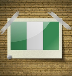 Flags Nigeriaat frame on a brick background vector image