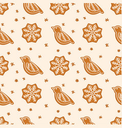 gingerbread cookies in shape of bird and snowflake vector image vector image