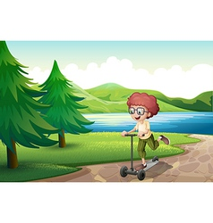 A boy playing with his scooter near the river vector image