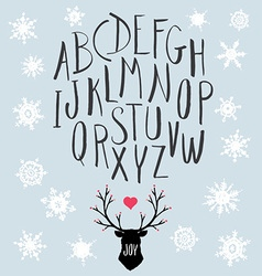 Hand drawn letters and stag with snowflakes set vector