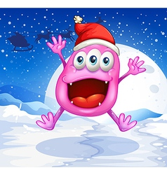 A happy pink monster jumping with a red hat vector