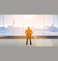 silhouette man waiting for arrival in airport hall vector image