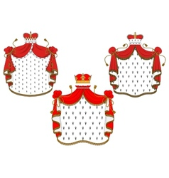 Royal red velvet mantels with golden crowns vector