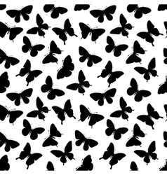 Seamless background with butterflies silhouettes vector