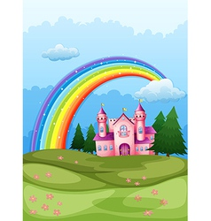 A castle at the hilltop with a rainbow in the sky vector