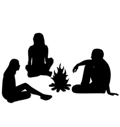 silhouettes of tourists sitting around a campfire vector image vector image