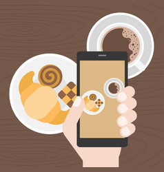 Hand holding smart phone take photo of coffee vector