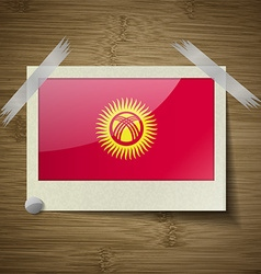 Flags kyrgyzstan at frame on wooden texture vector