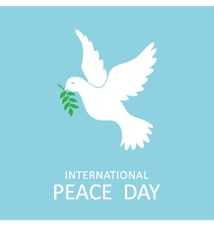 Peace dove with olive branch for peace day vector